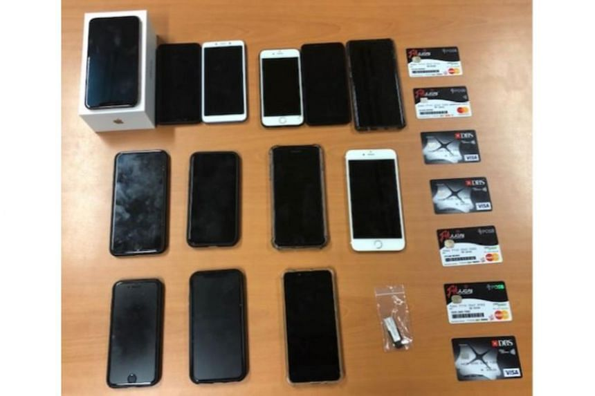 Mobile phones, debit cards and a thumb drive were seized as case exhibits.