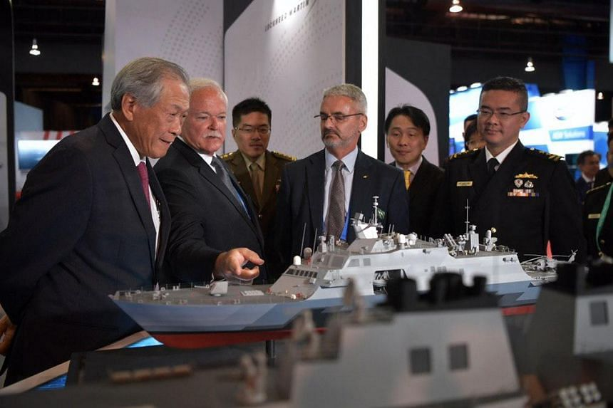 Defence Minister Ng Eng Hen (left) viewing an exhibit at the 12th International Maritime Defence Exhibition and Conference Asia, on May 14, 2019.