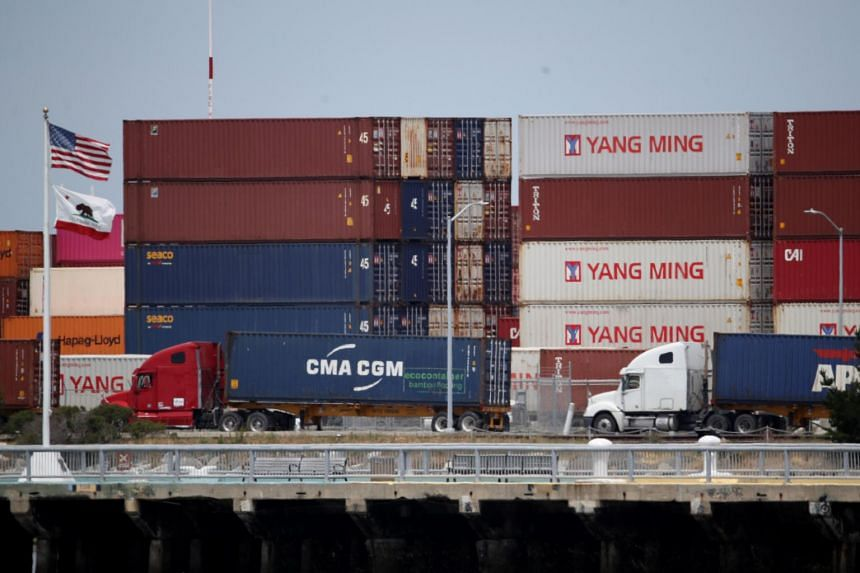 Trucks line up to enter a shipping berth at the Port of Oakland in California on May 13, 2019. US President Donald Trump has proposed putting tariffs on another US$300 billion (S$411 billion) in Chinese goods.