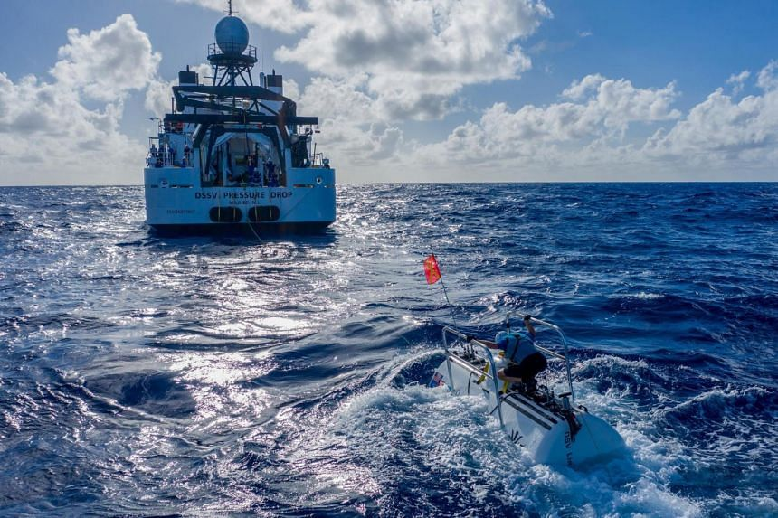The submarine DSV Limiting Factor floats near the research vessel DSSV Pressure Drop above the Pacific Ocean's Mariana Trench.