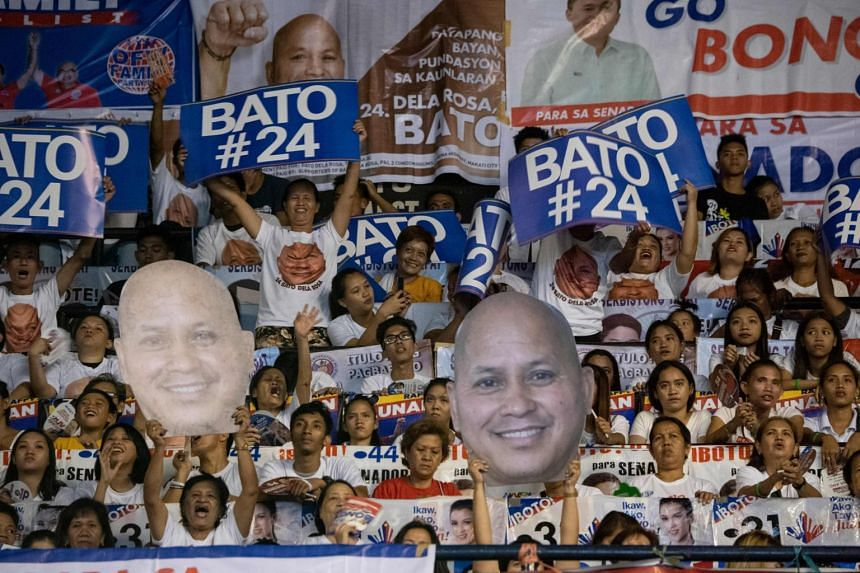 Supporters of Senatorial candidate Ronald Dela Rosa, the police chief who oversaw Mr Duterte's war on drugs, during a party meeting on May 11, 2019.
