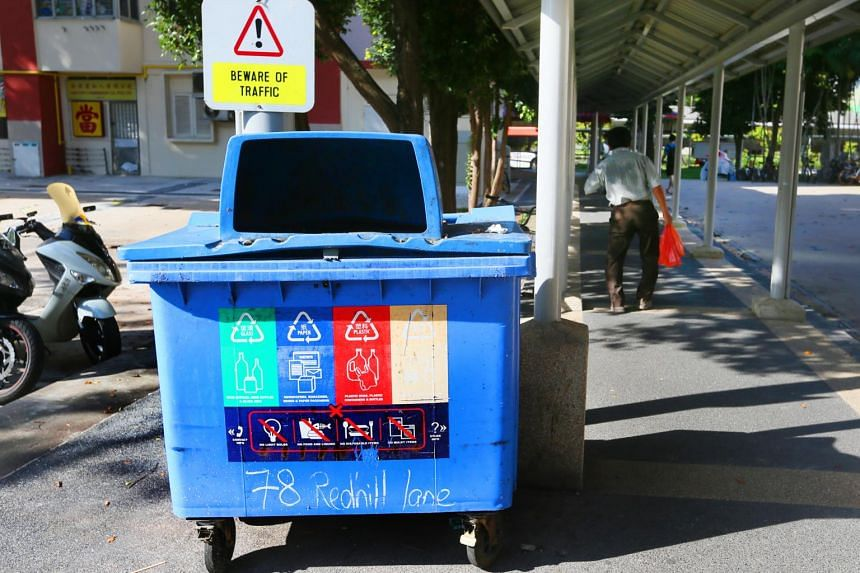 Some of the contents in blue recycling bins cannot be recycled as people deposit non-recyclables, such as tissue paper, in the bins.