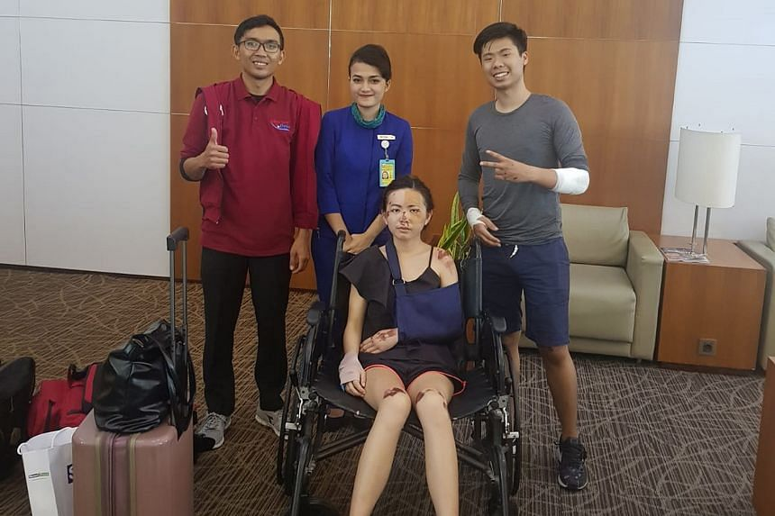 Mr Eugene Aathar and Ms Dolly Ho (above) at the airport with a MediVac Asia representative (in red) and an airport ground employee, and at Siloam Hospital Denpasar (right).