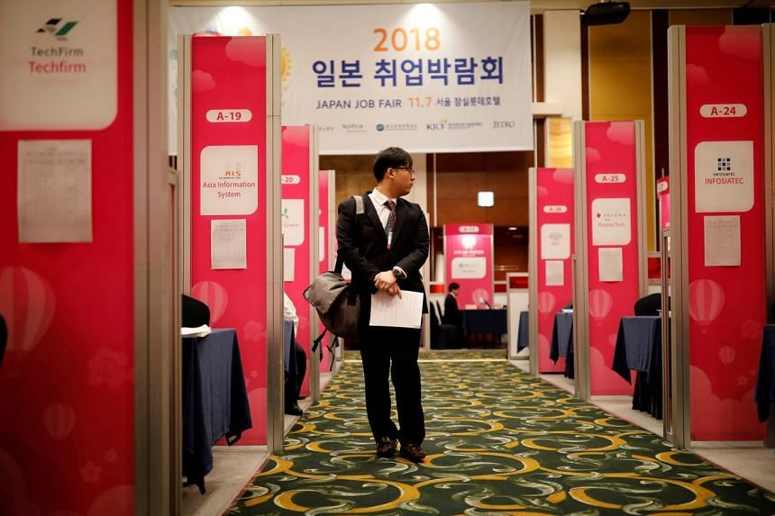 """A young South Korean at a 2018 Japan job fair in Seoul last year. State-run schemes aim to link young Koreans to """"quality jobs"""" overseas."""