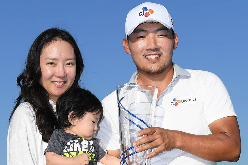 South Korean Kang Sung-hoon posing for a photo with his wife, Kang So-young and his son, Eugene, after winning the AT&T Byron Nelson at Trinity Forest Golf Club in Dallas on Sunday. He is now the 10th Korean to win on the PGA Tour.