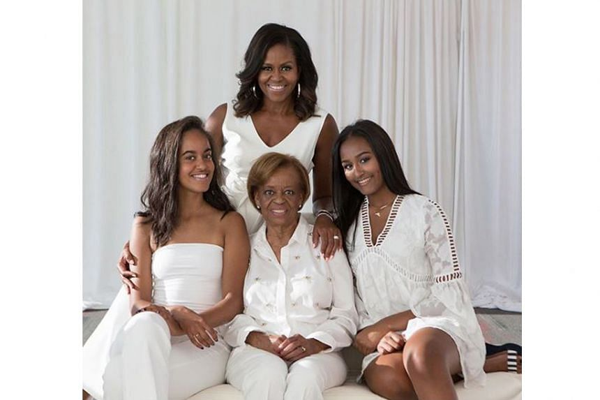 Mrs Michelle Obama (back, with daughters Malia Ann,left, and Sasha) honoured her mother Marian Robinson (centre) with a post on social media, which drew 2.6 million likes.
