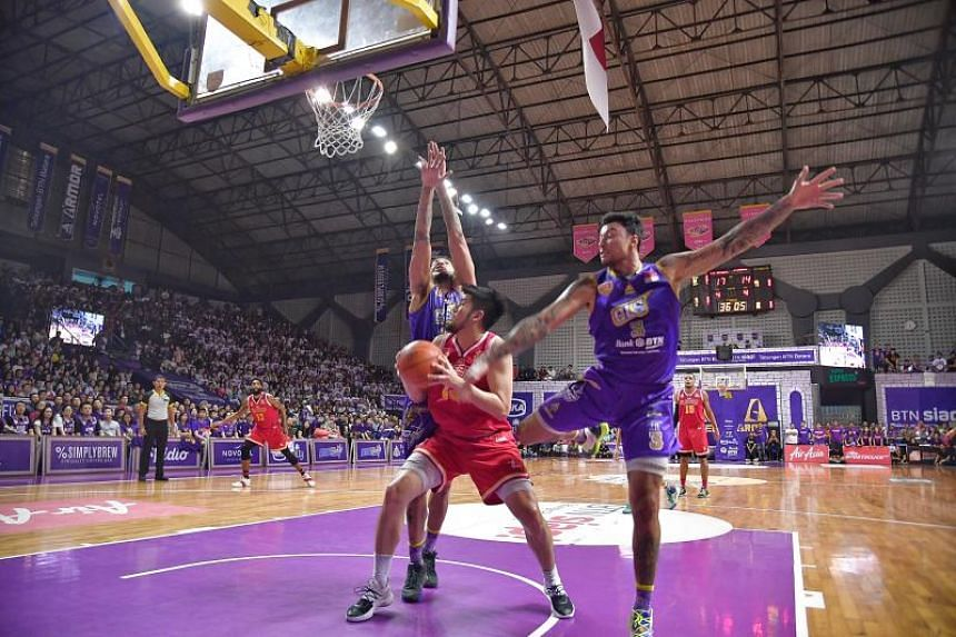 Singapore Slingers' Delvin Goh attempts to score during Game 3 of Asean Basketball League Finals against BTN CLS Knights in Surabaya, Indonesia, on May 8, 2019.