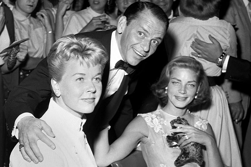 From left: Entertainers Doris Day, Frank Sinatra and Lauren Bacall at the Sands Hotel-Casino in Las Vegas in 1956. Actress Doris Day was known for her roles in films such as Pillow Talk (1959) and The Man Who Knew Too Much (1956).