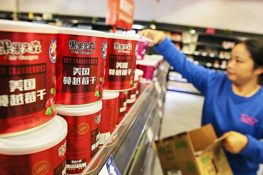 Cans of dry cranberries imported from the US on the shelves at a store in the Nantong Free Trade Zone in China's eastern Jiangsu province.