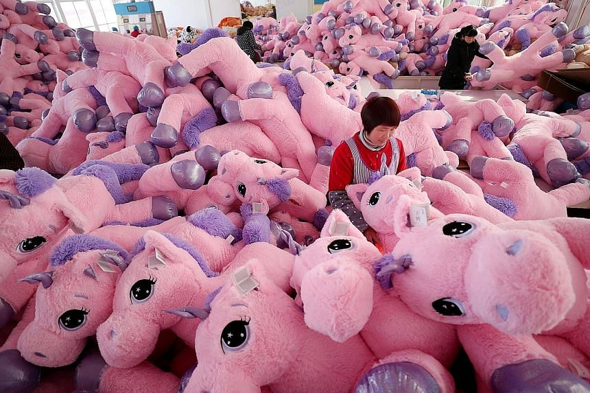 Workers making unicorn stuffed toys for export at a workshop in Lianyungang, in China's Jiangsu province. The US Trade Representative's office on Monday released a list of another US$300 billion worth of Chinese goods, including children's clothing,