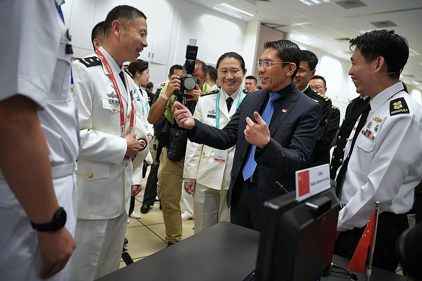 Senior Minister of State for Defence Maliki Osman speaking to delegates from China during the launch of the Information Fusion Centre's Iris portal, held in conjunction with the centre's 10th anniversary, at RSS Singapura - Changi Naval Base yesterda