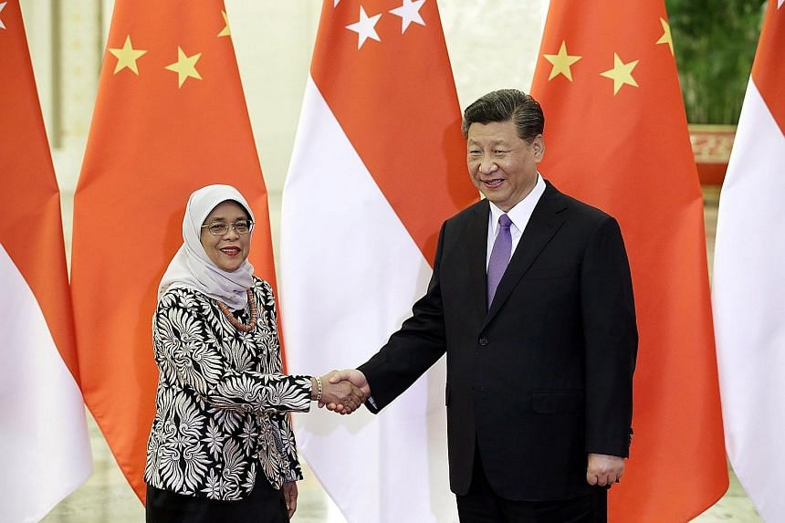 Visiting Singapore President Halimah Yacob meeting Chinese President Xi Jinping in Beijing's Great Hall of the People yesterday.