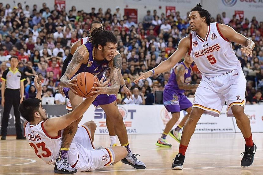 Delvin Goh (on ground) wants the Singapore Slingers to keep fighting until the final buzzer when they face CLS Knights Indonesia in tonight's deciding Game 5 of the Asean Basketball League Finals at the OCBC Arena.