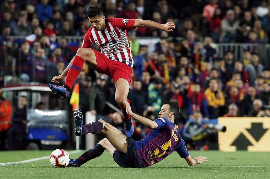 Atletico Madrid midfielder Rodri, evading a tackle by Barcelona's Sergio Busquets, is Manchester City's newest target. Whether he plays Champions League football next season with City is another question.