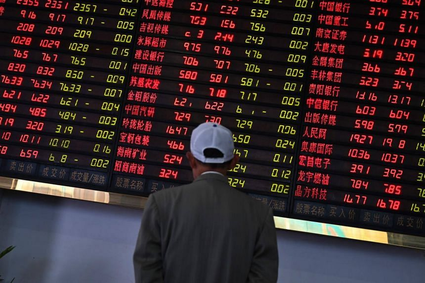Investors monitor stock price movements at a securities company in Shanghai, on May 8, 2019.
