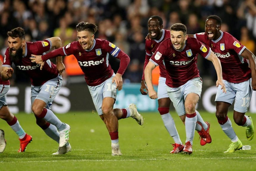 Aston Villa's Jack Grealish (left) and John McGinn celebrate after winning the penalty shootout against West Bromwich on May 14, 2019.