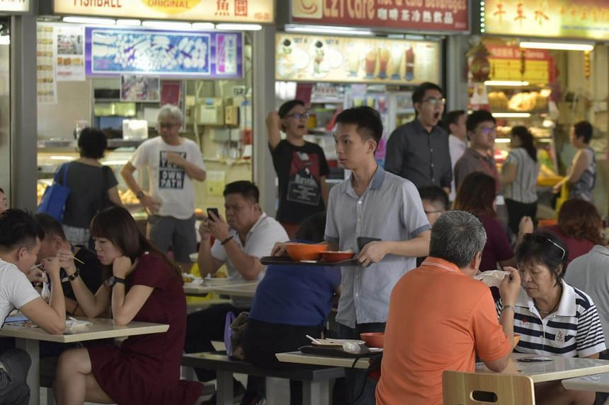 Customers eating at a hawker centre in Singapore.