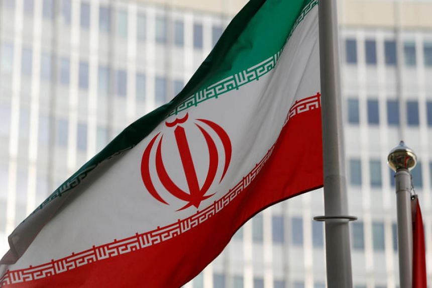 The Iranian flag flutters in front the International Atomic Energy Agency headquarters in Vienna, Austria, on March 4, 2019.