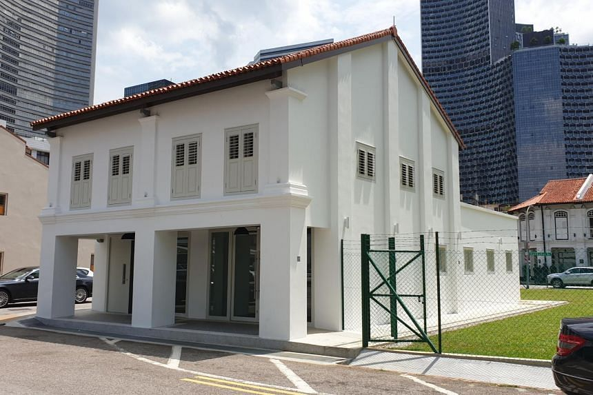 "Two shophouses at 45 Sultan Gate, located in the heart of the Kampong Glam district, yesterday became the first of six sites in existing areas of ""unique character"" to be put up for tender."