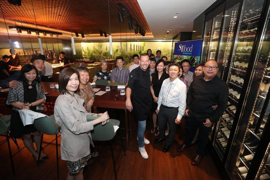 Subscribers of The Straits Times who won the five-course dinner worth $344++ at restaurant table65 were hosted by senior food correspondent Wong Ah Yoke (in white).