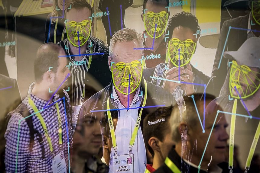 Attendees interact with a facial recognition demonstration during the Consumer Electronics Show in Las Vegas, Jan 8, 2019. The San Francisco board of supervisors has enacted the first ban by a major American city on the use of facial recognition tech