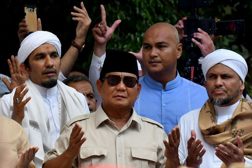 Presidential hopeful Prabowo Subianto with his supporters who gathered outside his home in Jakarta on April 19, 2019.