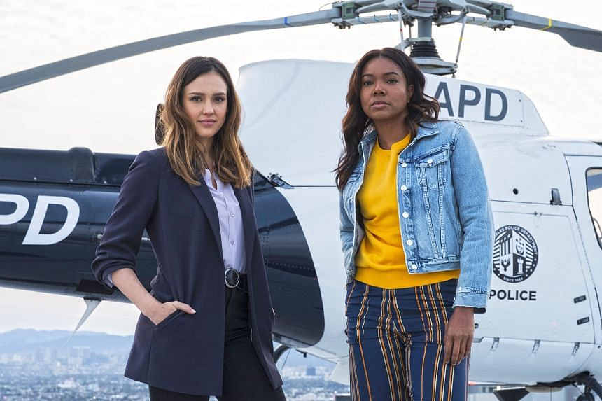 Jessica Alba (left) and Gabrielle Union (right) play tough-as-nails police officers with complicated histories in the new series, L.A.'s Finest.