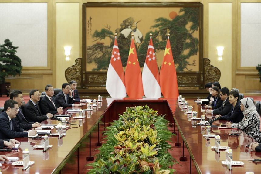 President Halimah Yacob and Chinese President Xi Jinping meeting in Beijing's Great Hall of the People yesterday. The leaders reaffirmed the strong and growing Sino-Singapore ties. Beside President Halimah is Minister for Culture, Community and Youth
