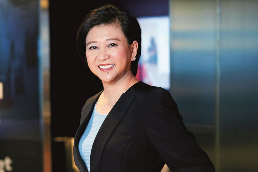 Singtel group CEO Chua Sock Koong. The telco posted a 21.4 per cent drop in full-year earnings, excluding one-off items - to $2.83 billion.