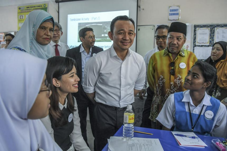 Education Minister Maszlee Malik (centre) having a light moment with students in Kuala Lumpur last month. Admission quotas to the programme, commonly known as matriculation, reserve 90 per cent of places for the bumiputera community.