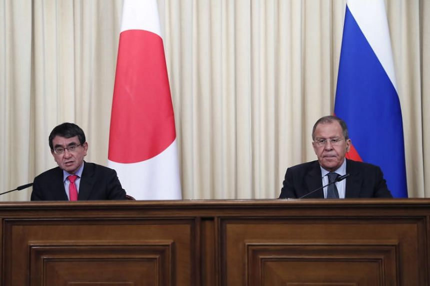 Japanese Foreign Minister Taro Kono (left) and Russian Foreign Minister Sergei Lavrov (right) attend a news conference following their meeting in Moscow, Russia, on May 10, 2019.