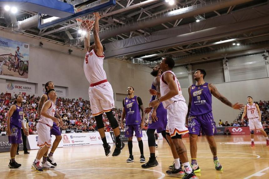 Singapore Slingers' John Fields dunking the ball during the match against CLS Knights Indonesia at the OCBC Arena, on May 15, 2019.