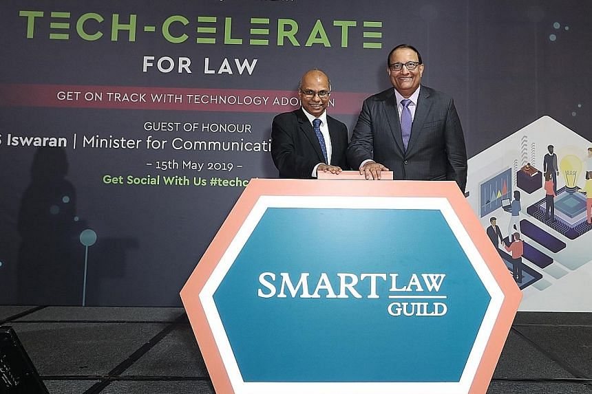 Law Society president Gregory Vijayendran (far left) with Minister for Communications and Information S. Iswaran at the launch of the SmartLaw Guild at the InterContinental Singapore yesterday.