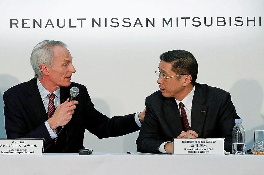 "Renault chairman Jean-Dominique Senard and Nissan chief executive Hiroto Saikawa at a news conference in Yokohama earlier this year. Nissan revealed on Tuesday that its operating profit will likely drop another 28 per cent to ""rock bottom"" in the cur"