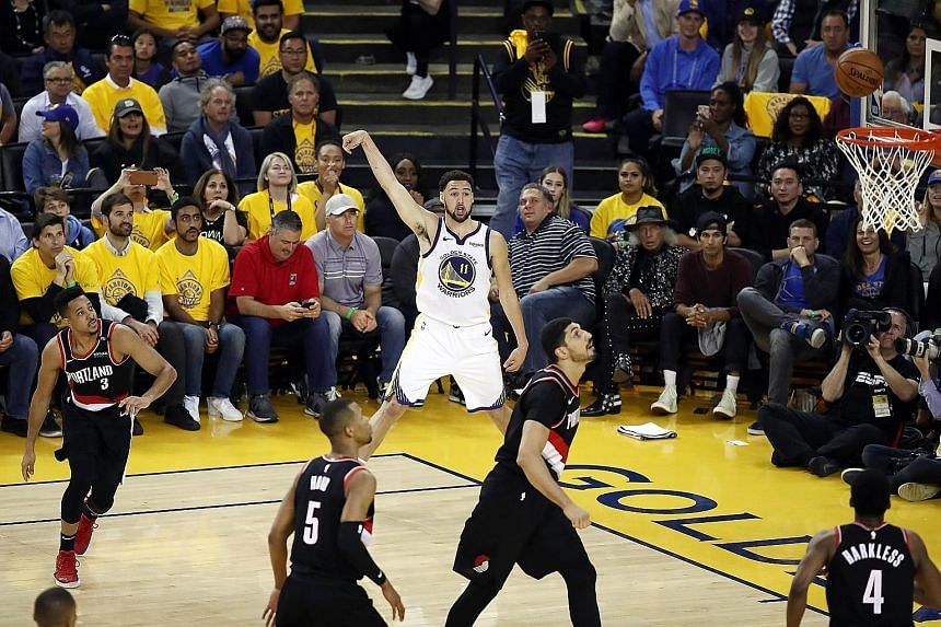 Klay Thompson watching his shot come good in the second half of the Western Conference Finals opener against the Portland Trail Blazers. Defending champions Golden State Warriors' superior shooting from distance dulled Portland's challenge. PHOTO: AG