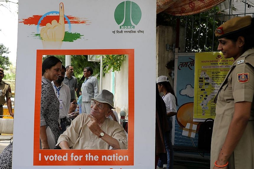 A voter posing in a photo booth after casting his ballot during the sixth phase of voting for national elections in New Delhi on Sunday. This year's elections stretch from April 11 to May 19, with the results to be announced on May 23. The multi-phas