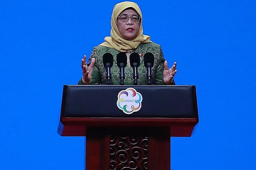 President Halimah Yacob speaking at the opening ceremony of the inaugural Conference on Dialogue of Asian Civilisations in Beijing yesterday, where she spoke of how Singapore safeguards its diversity. PHOTO: EPA-EFE