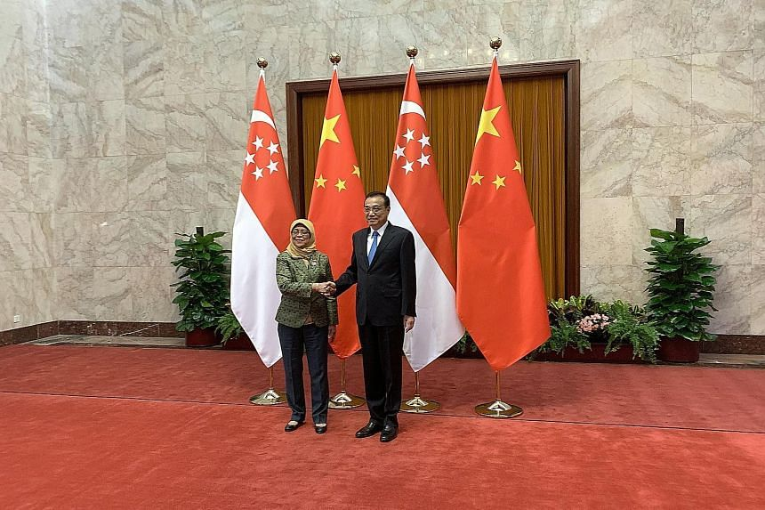 President Halimah Yacob meeting Chinese Premier Li Keqiang at the Great Hall of the People in Beijing yesterday. Earlier in the day, she met Mr Wang Huning, Secretary of the Chinese Communist Party's Central Committee Secretariat, at Diaoyutai, the s