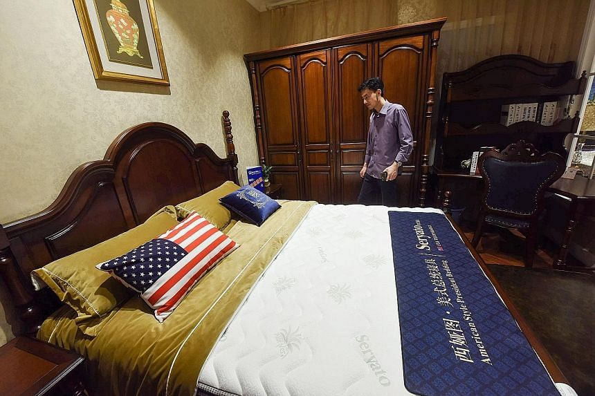 """A customer browsing in a shop with imported US furniture in Hangzhou, in China's Zhejiang province, on Tuesday. US President Donald Trump has denied that trade talks with China have broken down, describing dialogue between the two countries as """"very"""