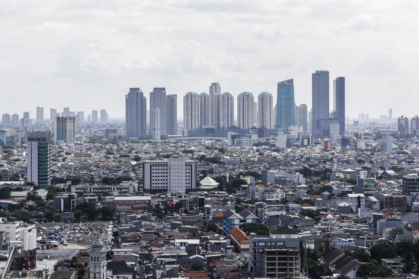 The skyline of Jakarta, Indonesia's capital city, on May 2, 2019. President Joko Widodo has a strategy of using infrastructure as a key plank to boost economic growth and spread wealth beyond the main island-powerhouse of Java, where the capital is l
