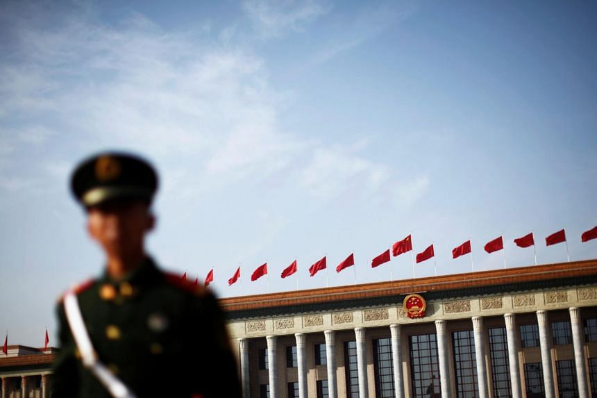 A police officer standing guard in front of the Great Hall of the People at Beijing's Tiananmen Square.