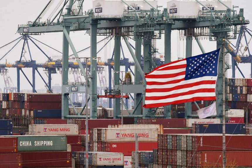Chinese shipping containers beside a US flag at the Port of Los Angeles in Long Beach, California, on May 14, 2019.