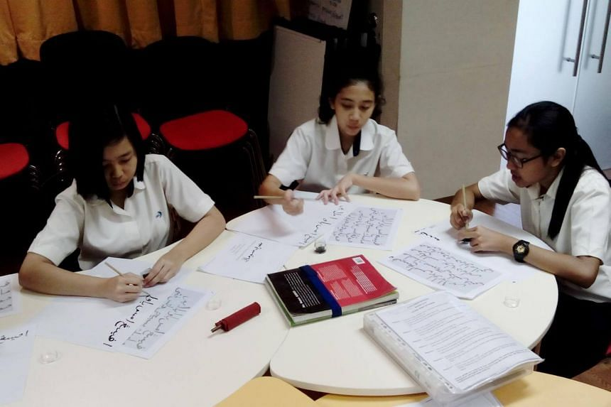 Students from Xinmin Secondary School learning how to write Jawi, the Arabic alphabet for writing the Malay language.