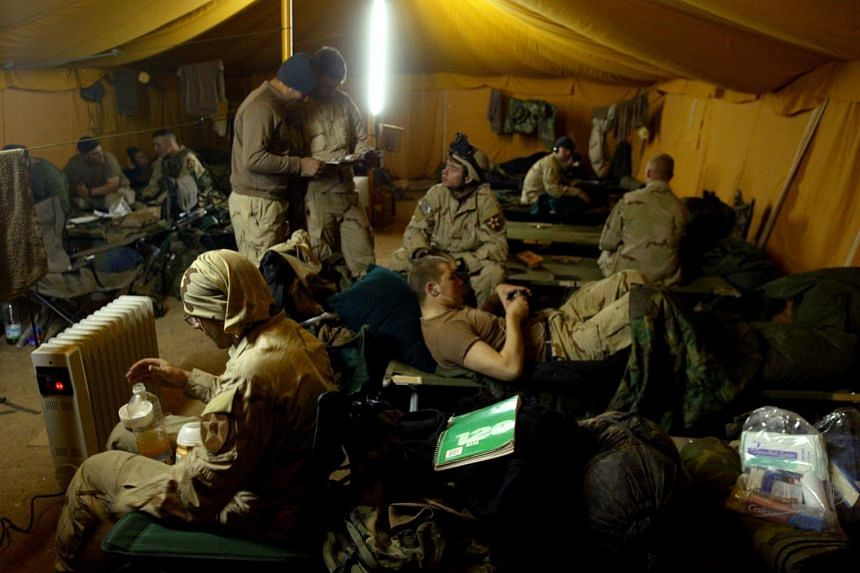 American soldiers in their tent in Ad Duluiyah, Iraq, on Dec 22, 2003.