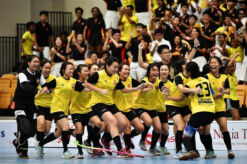 Victoria Junior College players celebrating their title with captain Caluza Denise Jazmine Carnate (No. 23) after she and Megan Ng scored in the 2-0 penalty shoot-out win over River Valley High School at the Our Tampines Hub yesterday. The match had