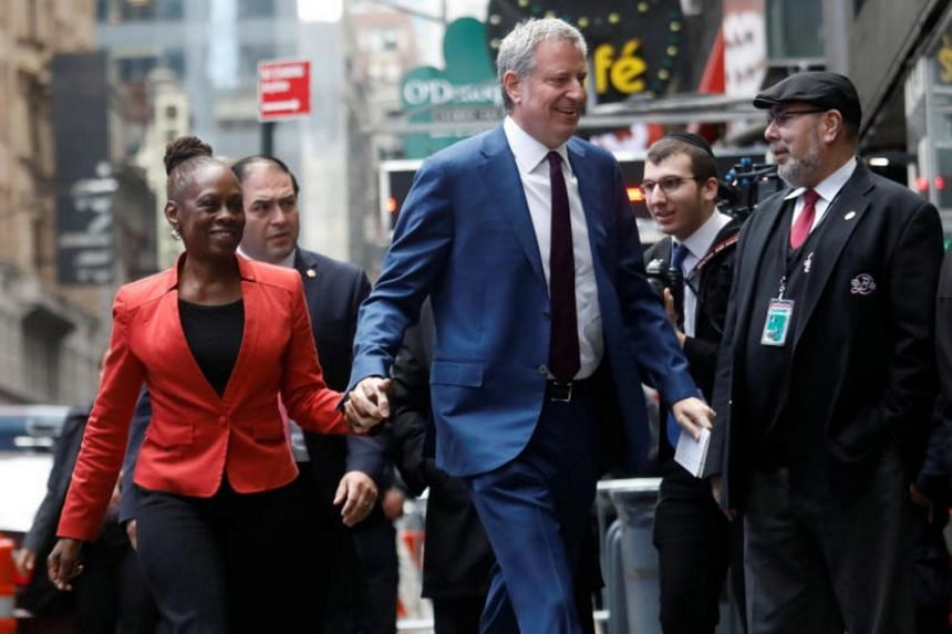 New York City Mayor Bill de Blasio and his wife Chirlane McCray arrive at the Good Morning America show in New York City on May 16, 2019, after Mr de Blasio announced his candidacy for the Democratic presidential nomination.