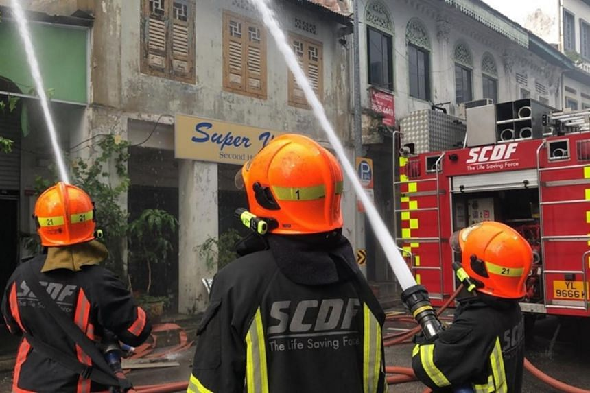 Singapore Civil Defence Force personnel conducting firefighting operations.