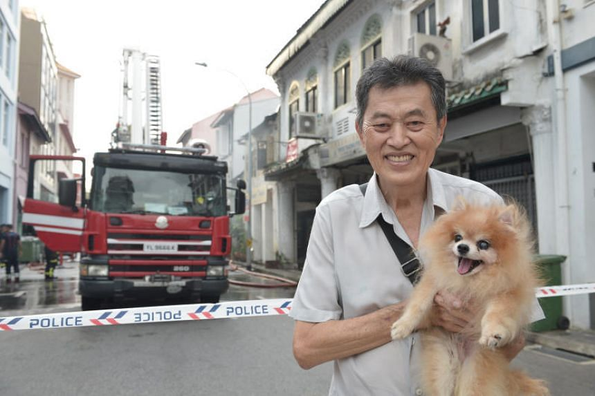 Retiree Peter Lim told ST in Mandarin that the police had gone up to check for remaining occupants and rescued his dog, who has been with him for 10 years.