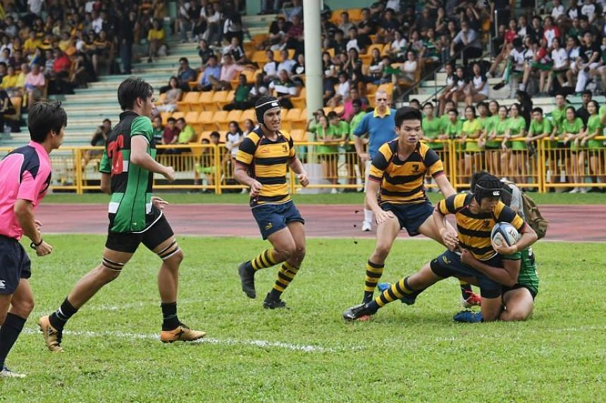 Anglo-Chinese School (Independent) (in yellow and blue stripes) beat Raffles Institution (in green) 14-8 in the A Division rugby finals held in Queenstown Stadium on May 16, 2019.