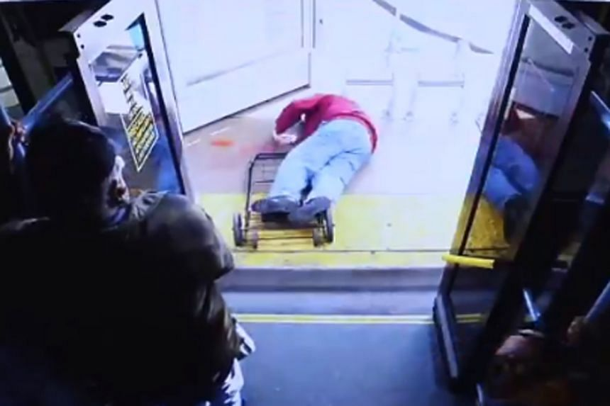 A surveillance video showed Mr Serge Fournier landing face down on the sidewalk on top of his collapsed shopping cart after being shoved off a bus by a woman.
